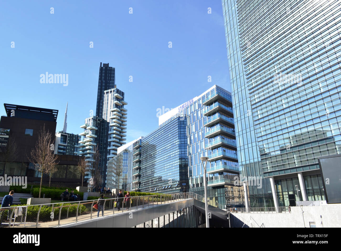 Milan/Italy - March, 28, 2015: Modern highly technological look of the new managerial district Porta Nuova and view to garden and passage. Stock Photo
