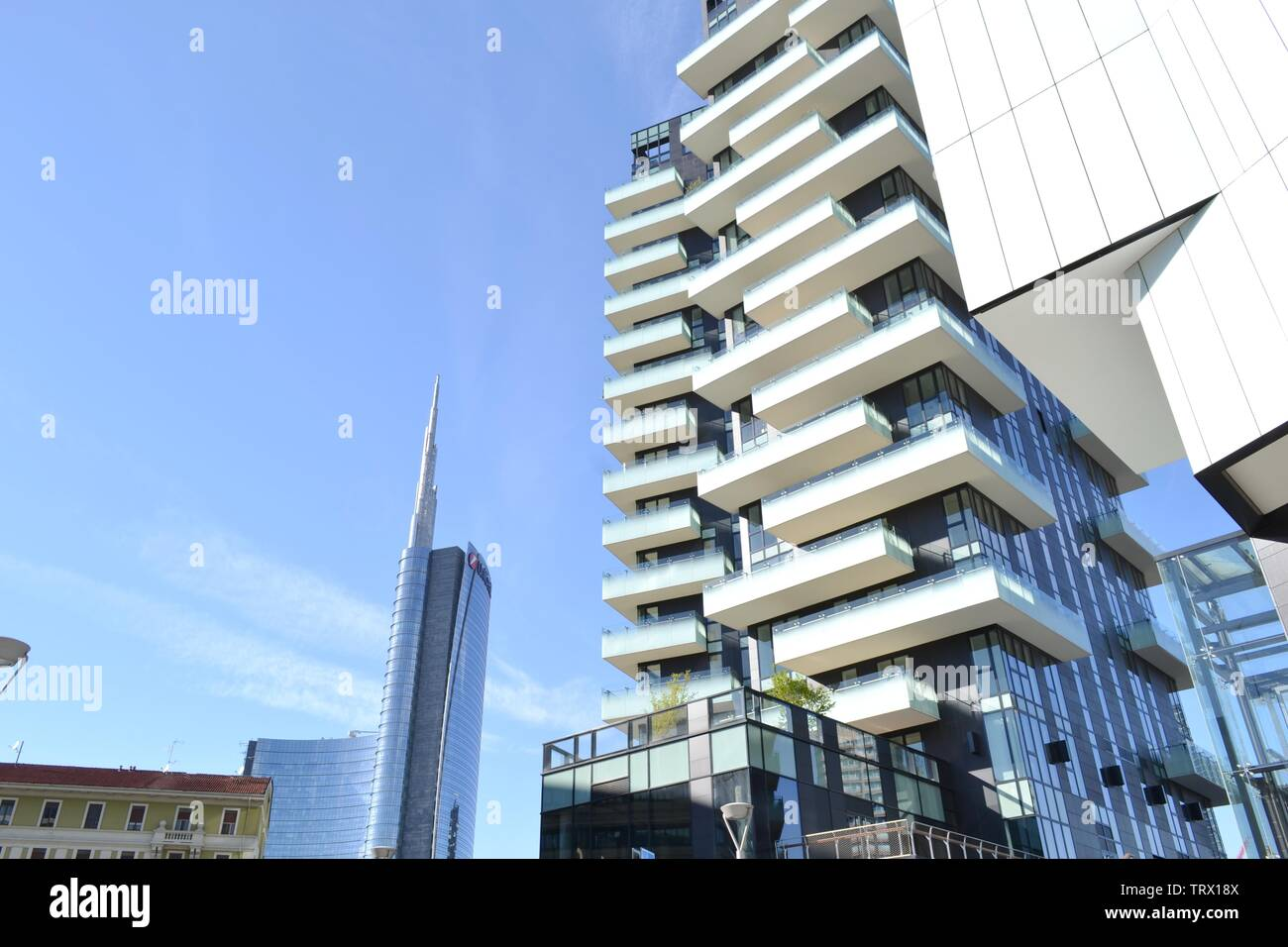 Milan/Italy - March, 28, 2015: Modern highly technological look of a new residence part of Porta Nuova district and Unicredit skyscraper in background Stock Photo