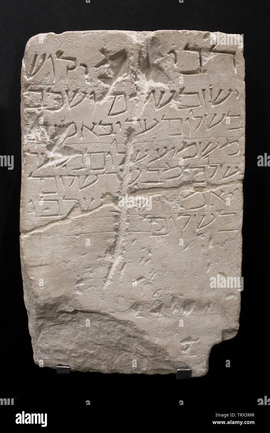 Cordoba, Spain - Dec 7th, 2018: Gravestone of Rabi Amicos. 12th Century AC, Limestone, Lucena, Cordoba. Archaelogical Museum, Spain - Stock Image