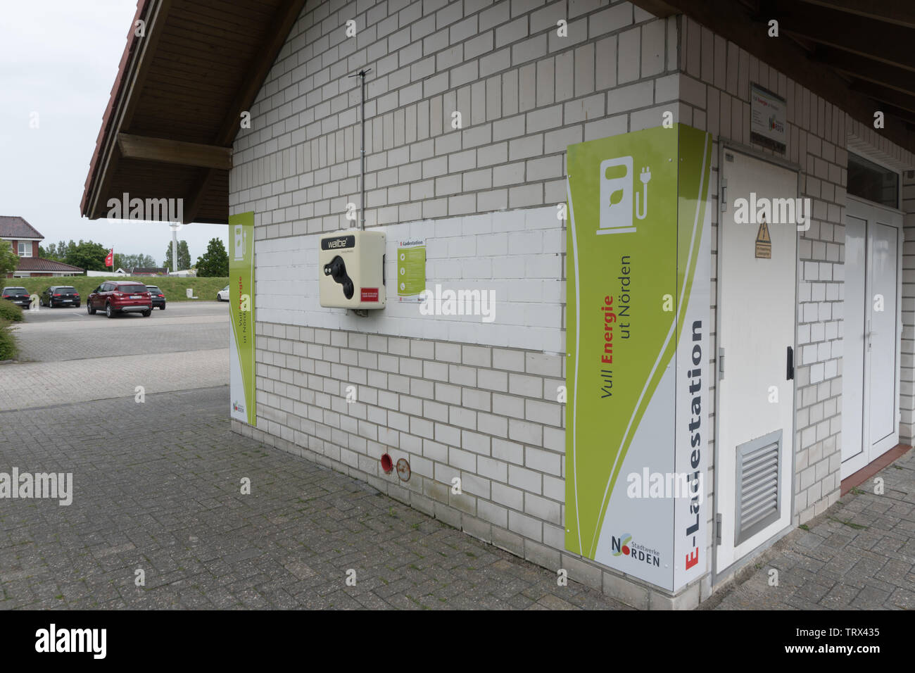 Car charging point in car park, East Frisia, Lower Saxony. Germany. - Stock Image