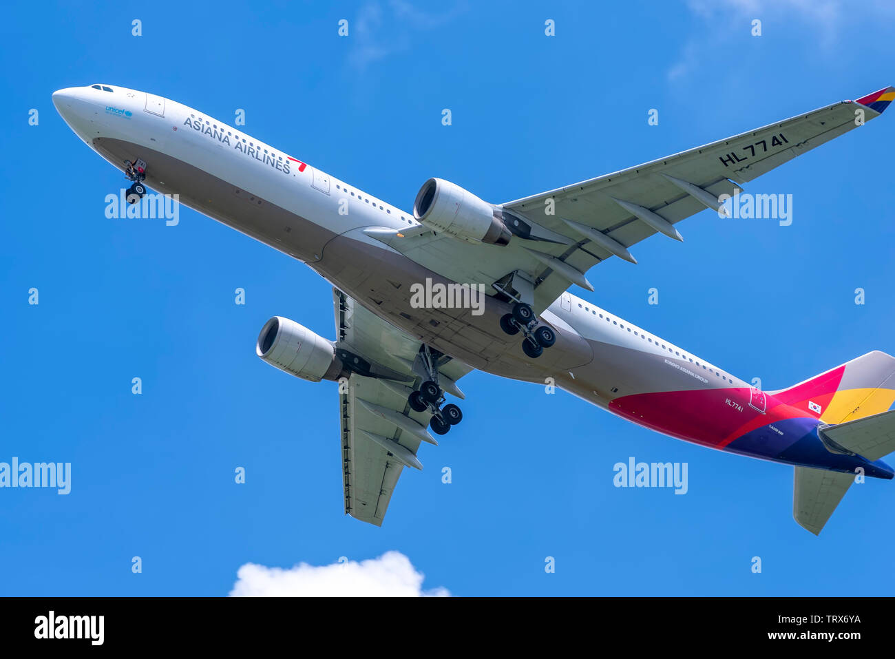 Passenger airplane Airbus A330 of Asiana Airlines flying through clouds sky take off from Tan Son Nhat International Airport, Ho Chi Minh City, Vietna - Stock Image