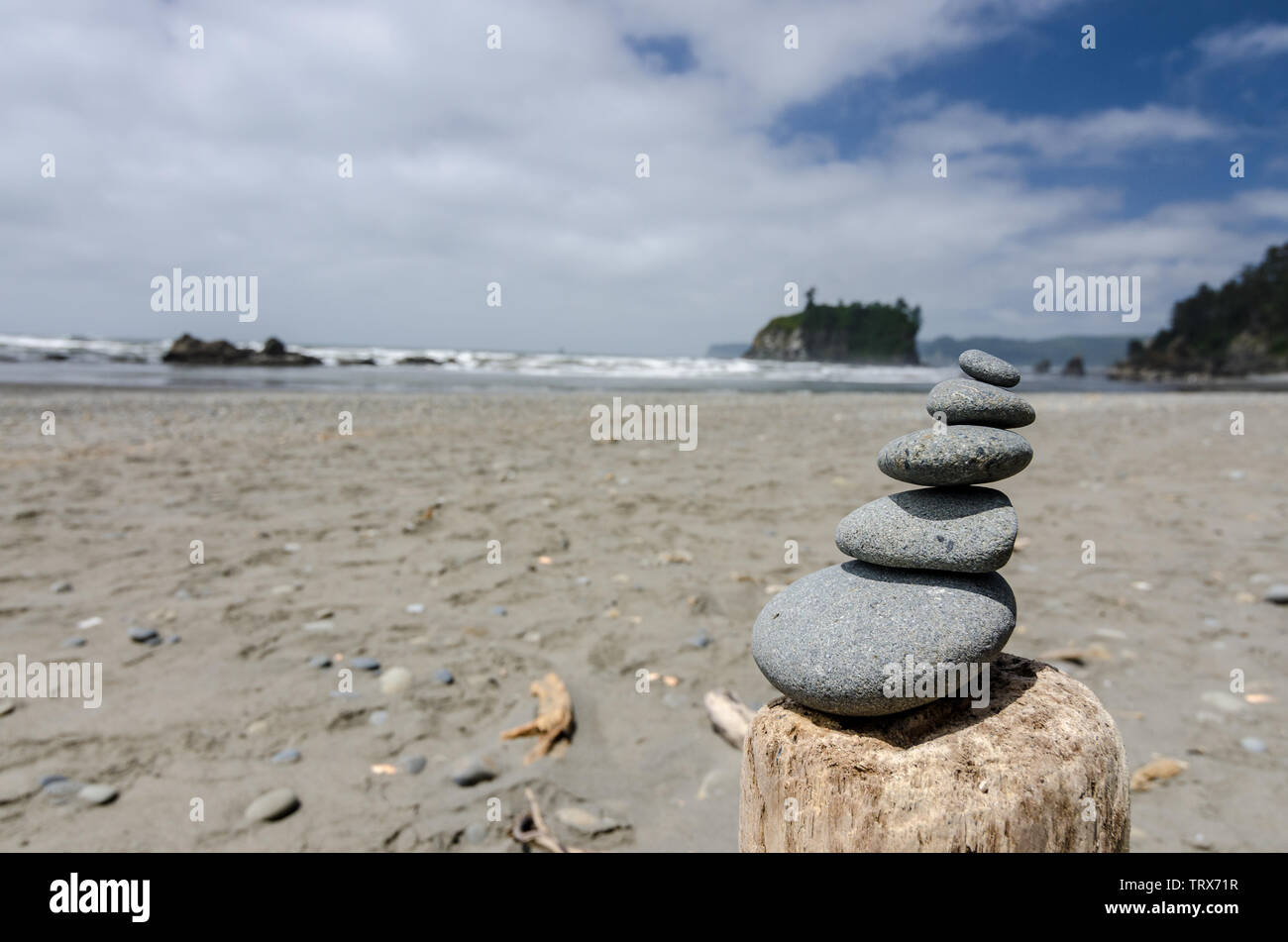 stone stacking at the beach somewhere in USA - Stock Image