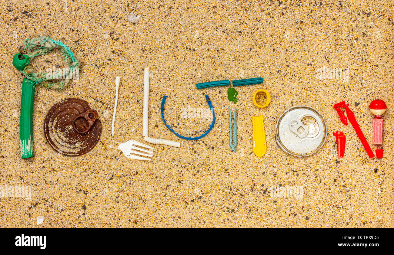 Pollution text made from real single use plastic rubbish found on beach - Stock Image