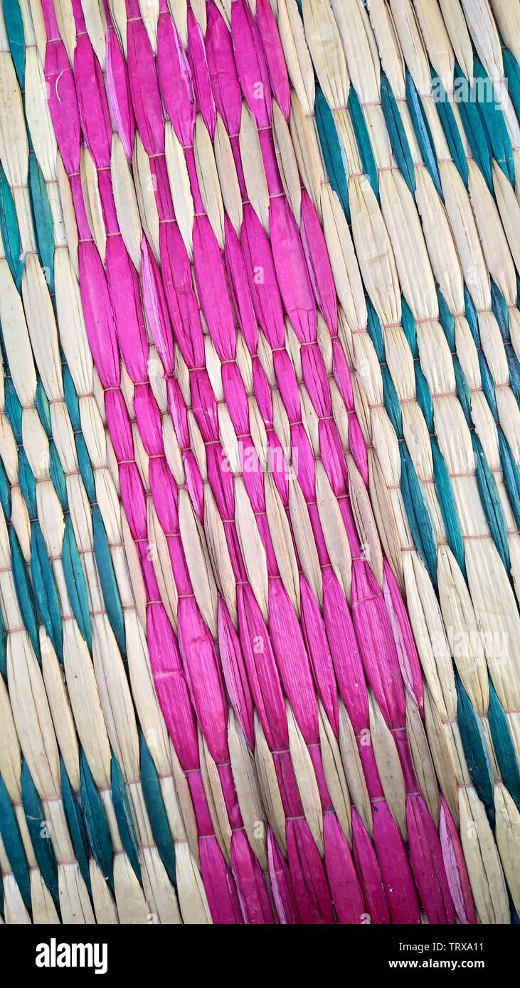 Weave grass background. fabricate from grass - Stock Image