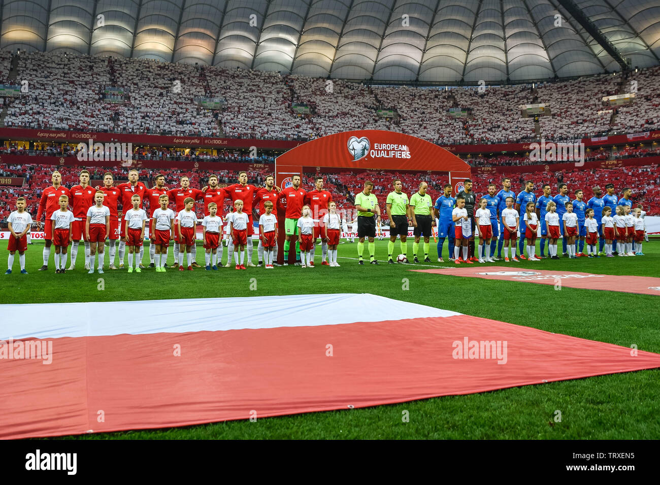 WARSAW, POLAND - JUNE 10, 2019: Qualifications Euro 2020  match Poland - Israel 4:0. Team of Poland (L) and Israel (R) during anthem. - Stock Image