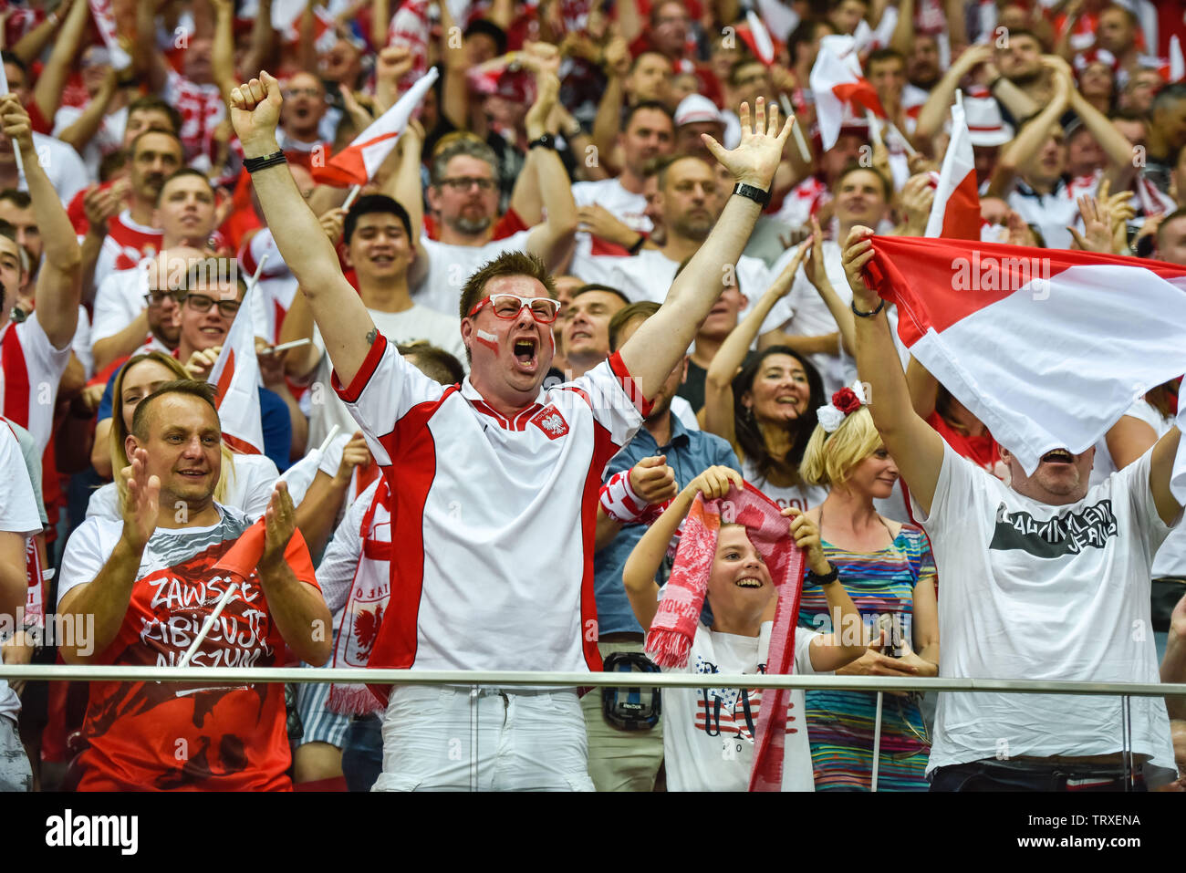 WARSAW, POLAND - JUNE 10, 2019: Qualifications Euro 2020  match Poland - Israel 4:0. Supporters of Poland joy after scoring goal. - Stock Image