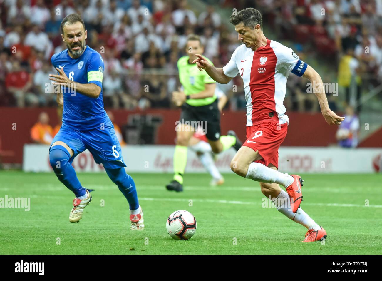 WARSAW, POLAND - JUNE 10, 2019: Qualifications Euro 2020  match Poland - Israel 4:0. In action  Bibras Natcho (L) and Robert Lewandowki (R). - Stock Image