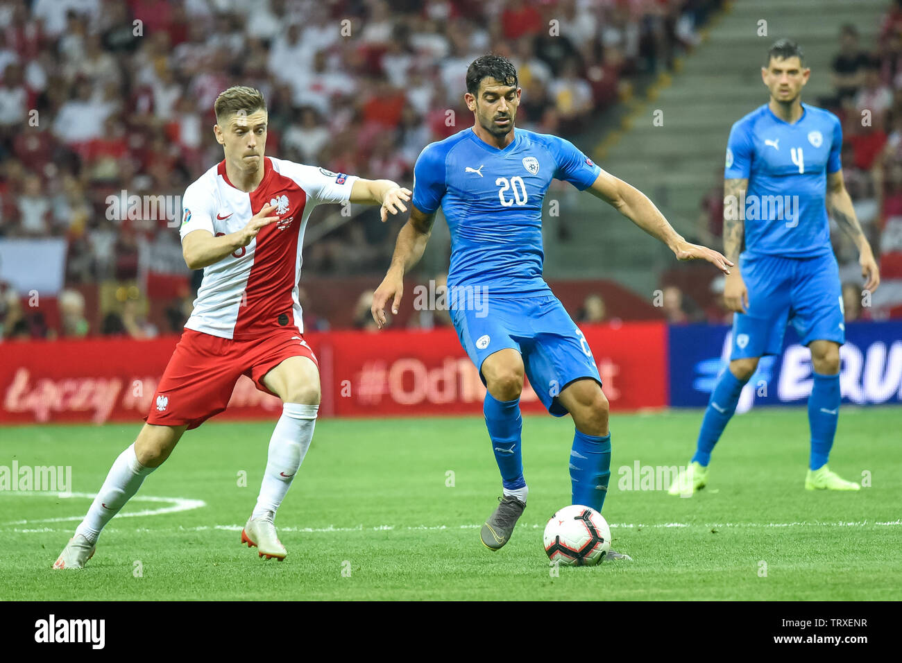 WARSAW, POLAND - JUNE 10, 2019: Qualifications Euro 2020  match Poland - Israel 4:0. In action Krzysztof Piatek (L) and Omri Ben Harush (R). - Stock Image