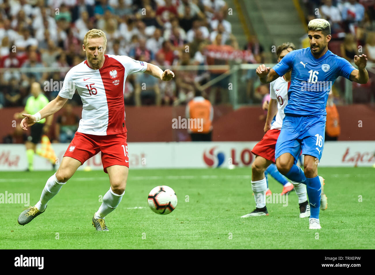 WARSAW, POLAND - JUNE 10, 2019: Qualifications Euro 2020  match Poland - Israel 4:0. In action Kamil Glik (L) and Yonatan Cohen (R). - Stock Image