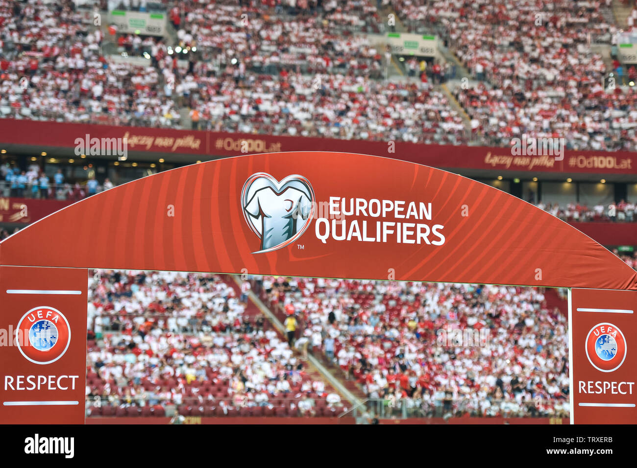 WARSAW, POLAND - JUNE 10, 2019: Qualifications Euro 2020  match Poland - Israel 4:0. Board with with logos and subtitles 'European Qualifiers' and 'UE - Stock Image