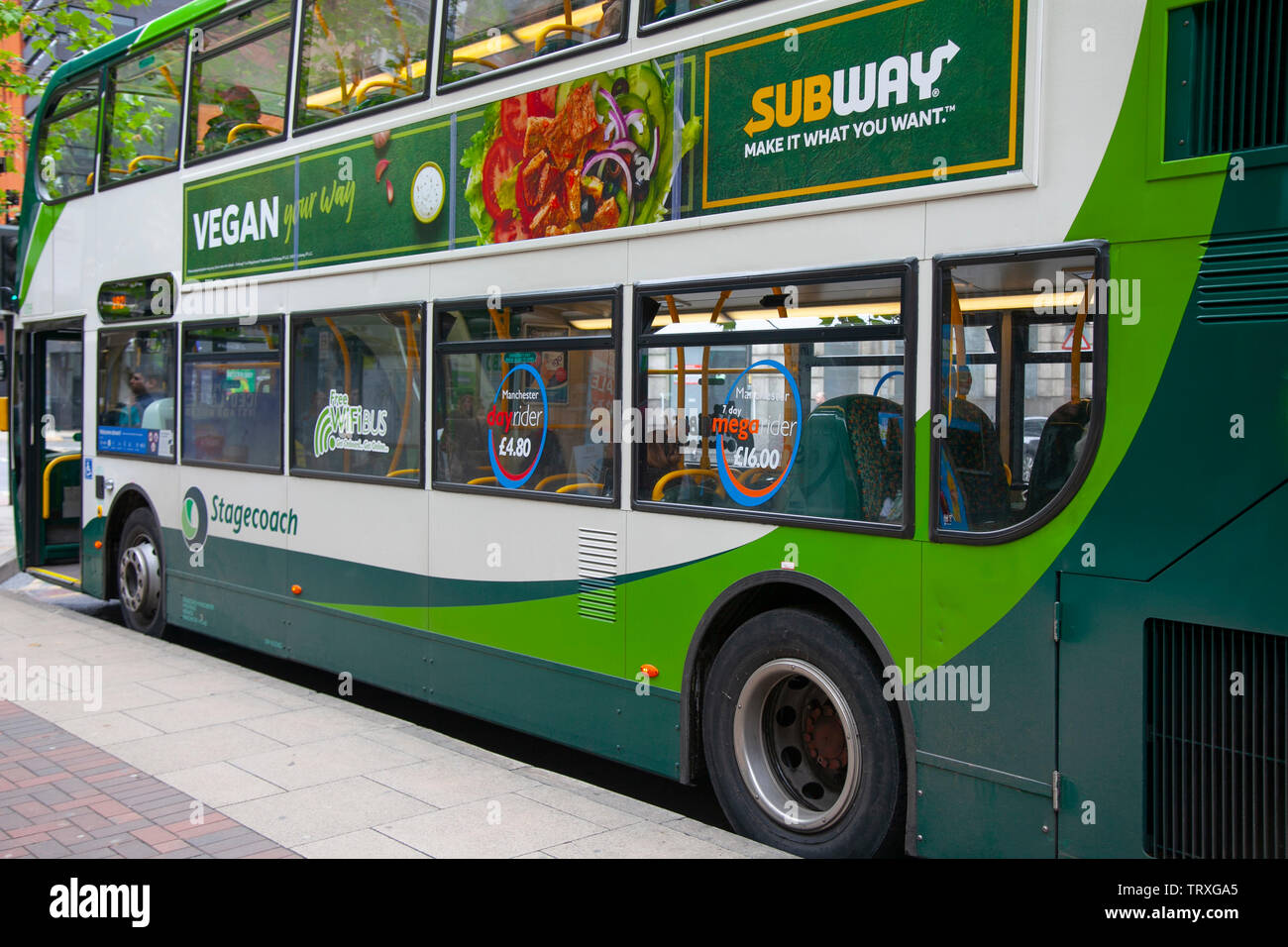 Subway vegan advertising on Stagecoach bus in Manchester, UK - Stock Image