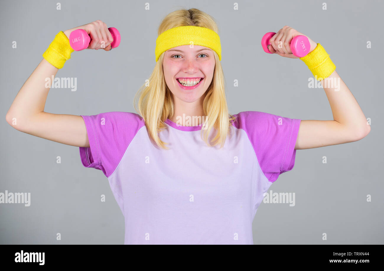 Workout with dumbbell. Workout sport and dieting. Woman workout in gym with sport equipment. Woman fitness coach exercising with dumbbell. Easy biceps - Stock Image