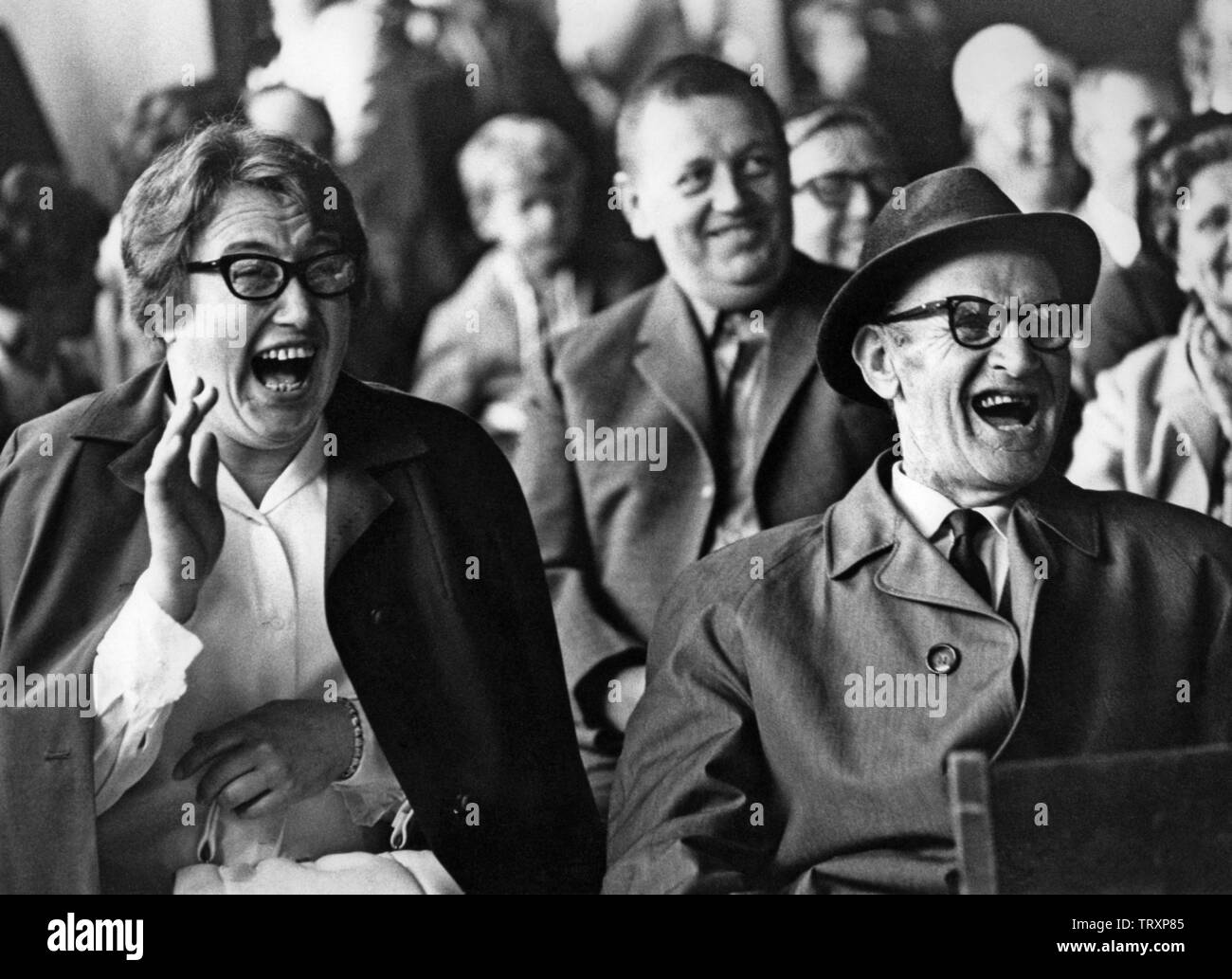 Audience in the 1960s. They are all laughing at something or someone on the  stage. Sweden 1960s Stock Photo - Alamy