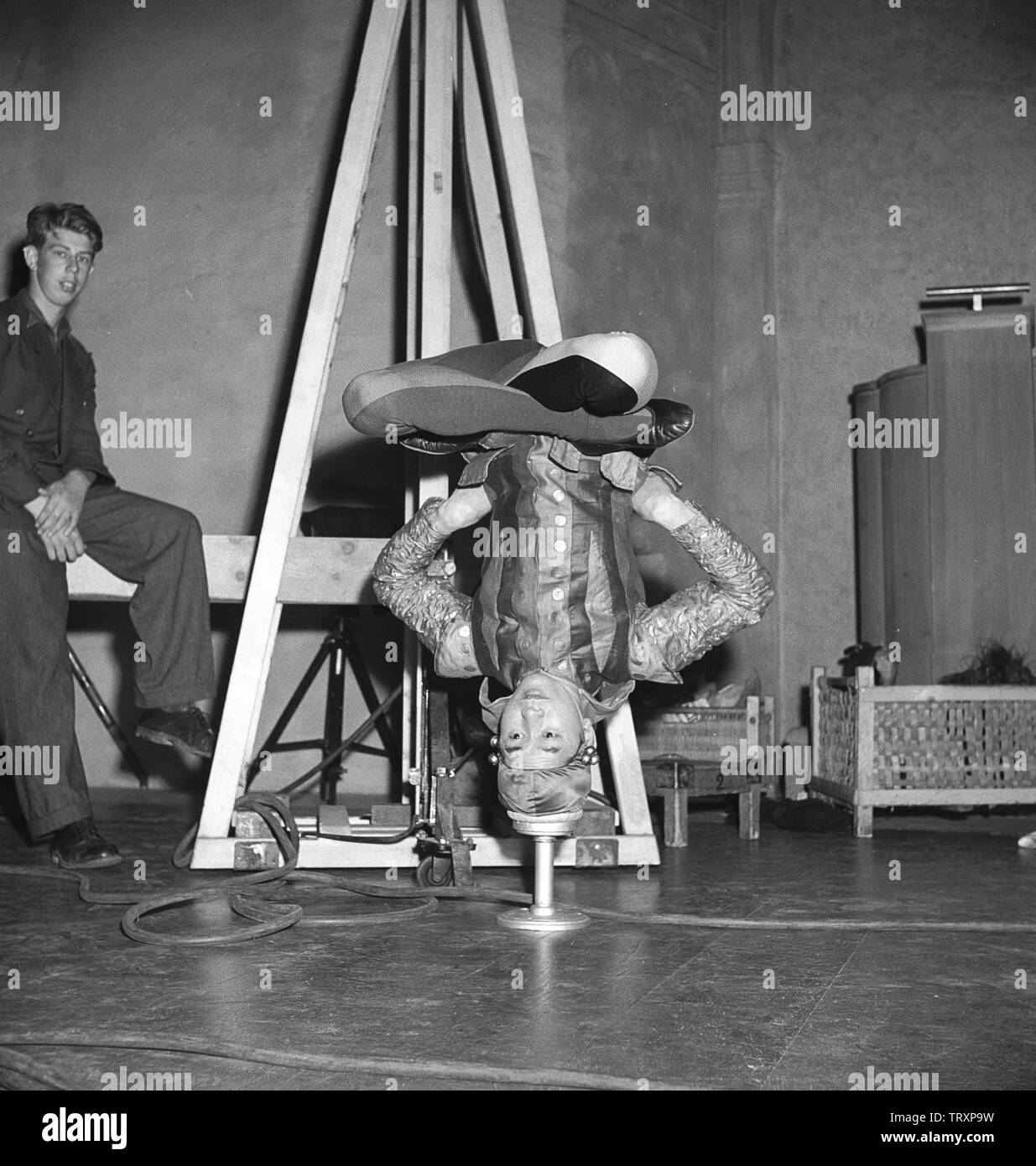 Balanced in the 1940s. A Young acrobatic man is standing on only his head and balancing his body in perfection with no help to stay that way by any means. Sweden 1946 Kristoffersson ref U66-3 - Stock Image