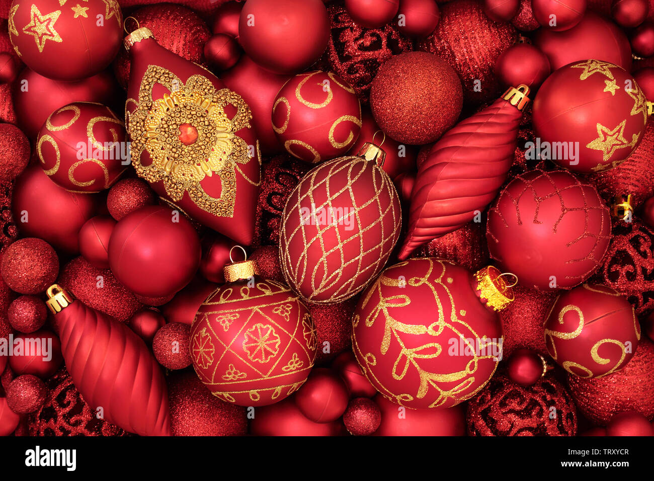 red and gold christmas tree bauble decorations forming an abstract background traditional theme with symbols for the holiday season TRXYCR