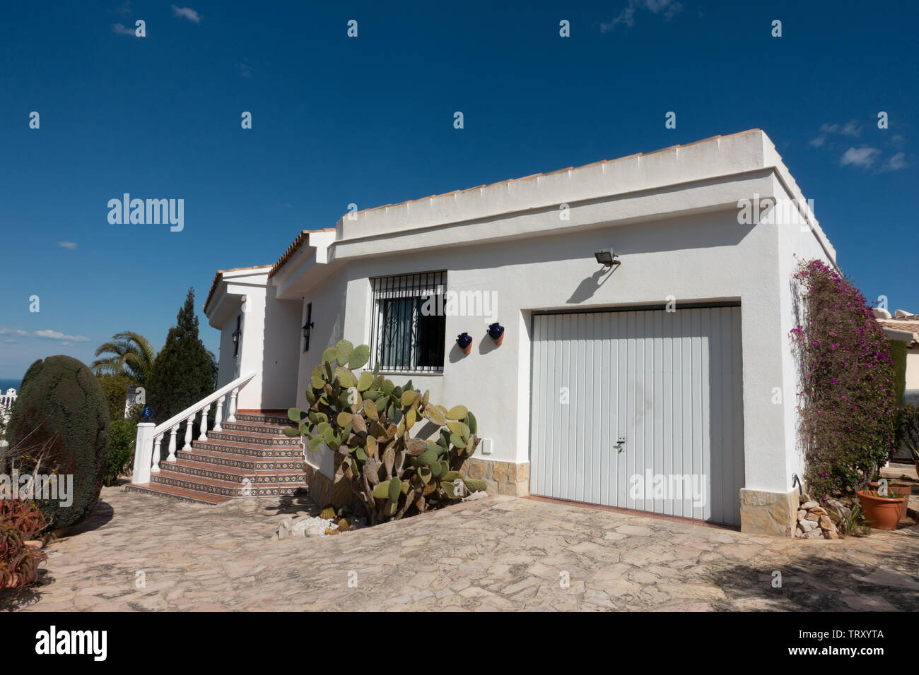 Spanish villa against a blue sky - Stock Image