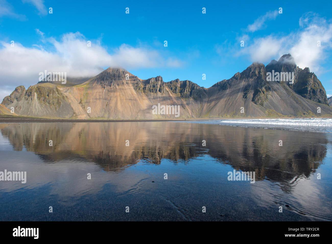 Icelandic landscape, reflection of Vestrahorn mountain in the waters of the Atlantic ocean. Stokksnes peninsula, Hofn, Iceland Stock Photo
