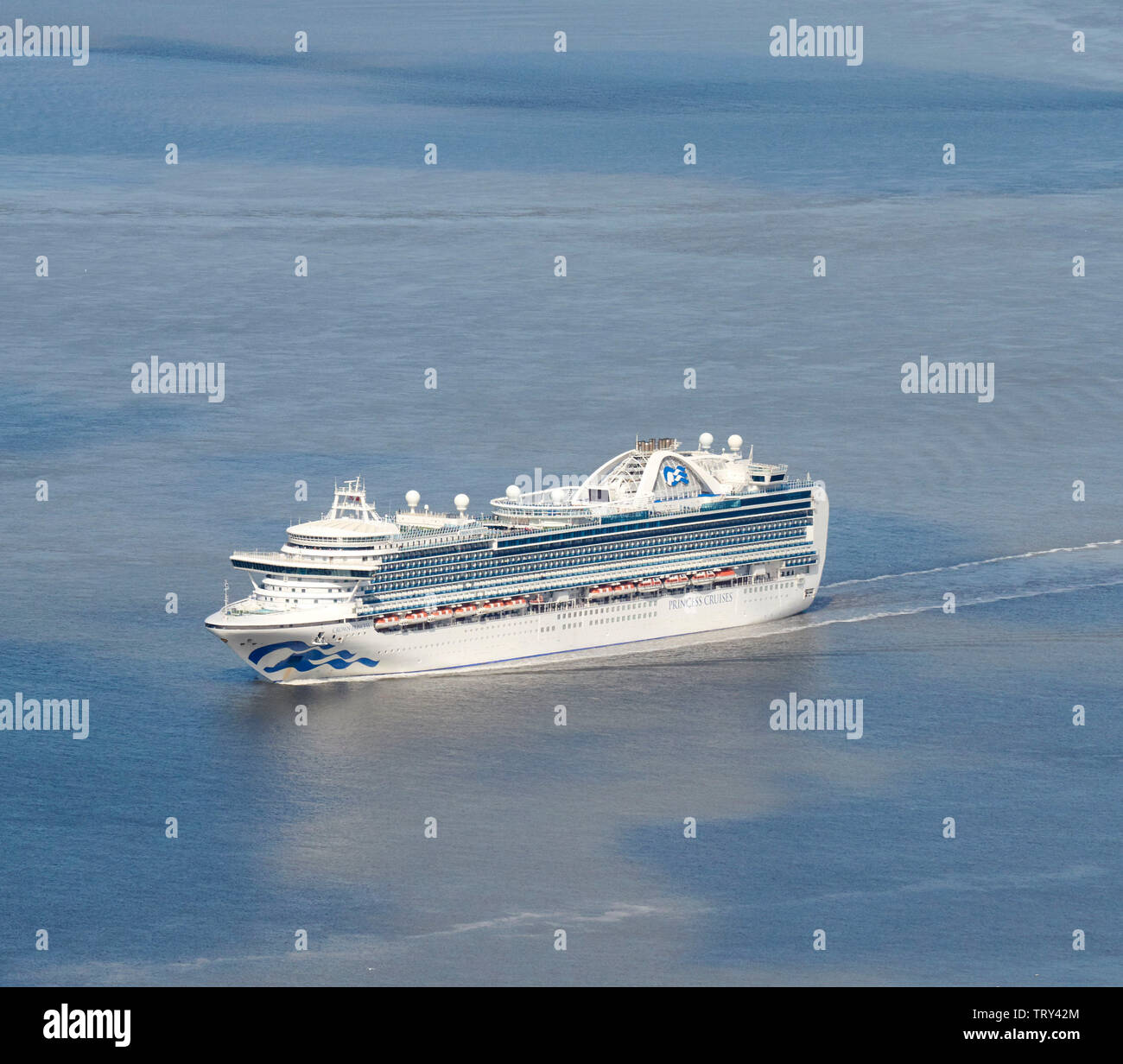 Crown Princess cruise ship, sailing into Liverpool on Mersey Estuary, North West England, UK - Stock Image