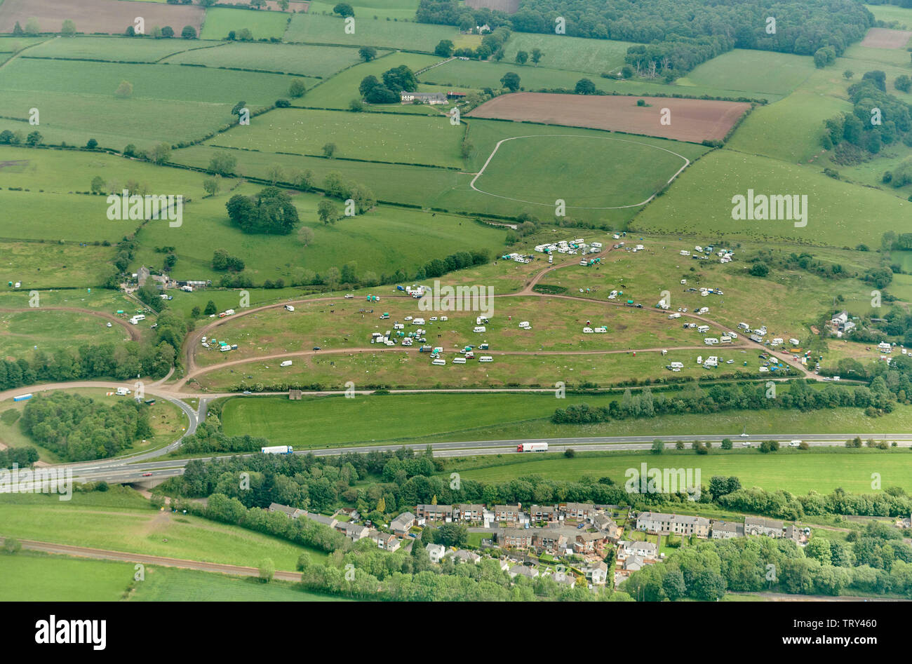 An aerial view of Appleby Fair, A66 trunk road foreground, Cumbria, Northern England, UK - Stock Image