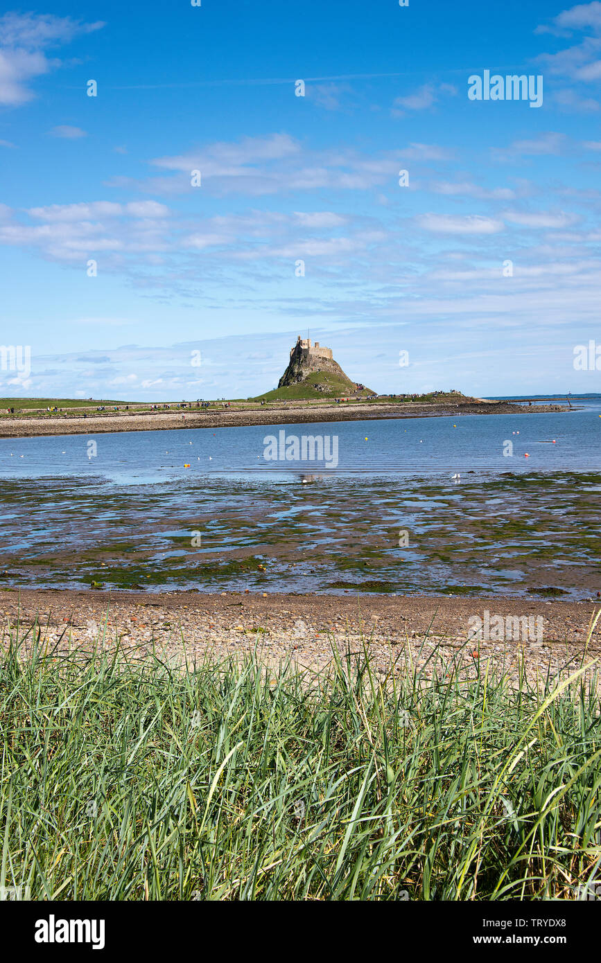 Lindisfarne Castle Stands on a Whinstone Hill Overlooking Holy Island Harbour Northumberland England United Kingdom UK Stock Photo