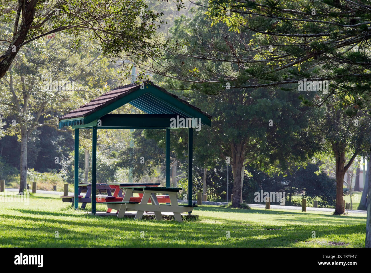 A terracotta tile roofed picnic eating area in a lush green park at Hallidays Point on the NSW mid north coast of Australia - Stock Image