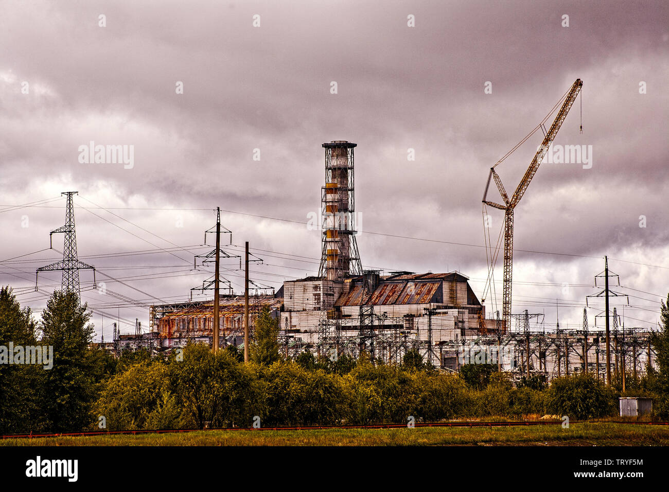 Chernobyl, Pripryat Ukraine. This is Reactor 4, THE  reactor that caught fire and caused the nuclear accident which made Chernobyl a household name, and ultimately caused the fall of the Berlin Wall. It sits on the Pripryat River, which was used to cool the core. It is one of six reactors all close together. The Chernobyl Nuclear Power Plant is in the north of Ukraine, very near the border with Belarus. Chernobyl itself was overtaken in size and importance by the new Atomic City of Pripryat, just a couple of Kilomteres from this reactor. Stock Photo