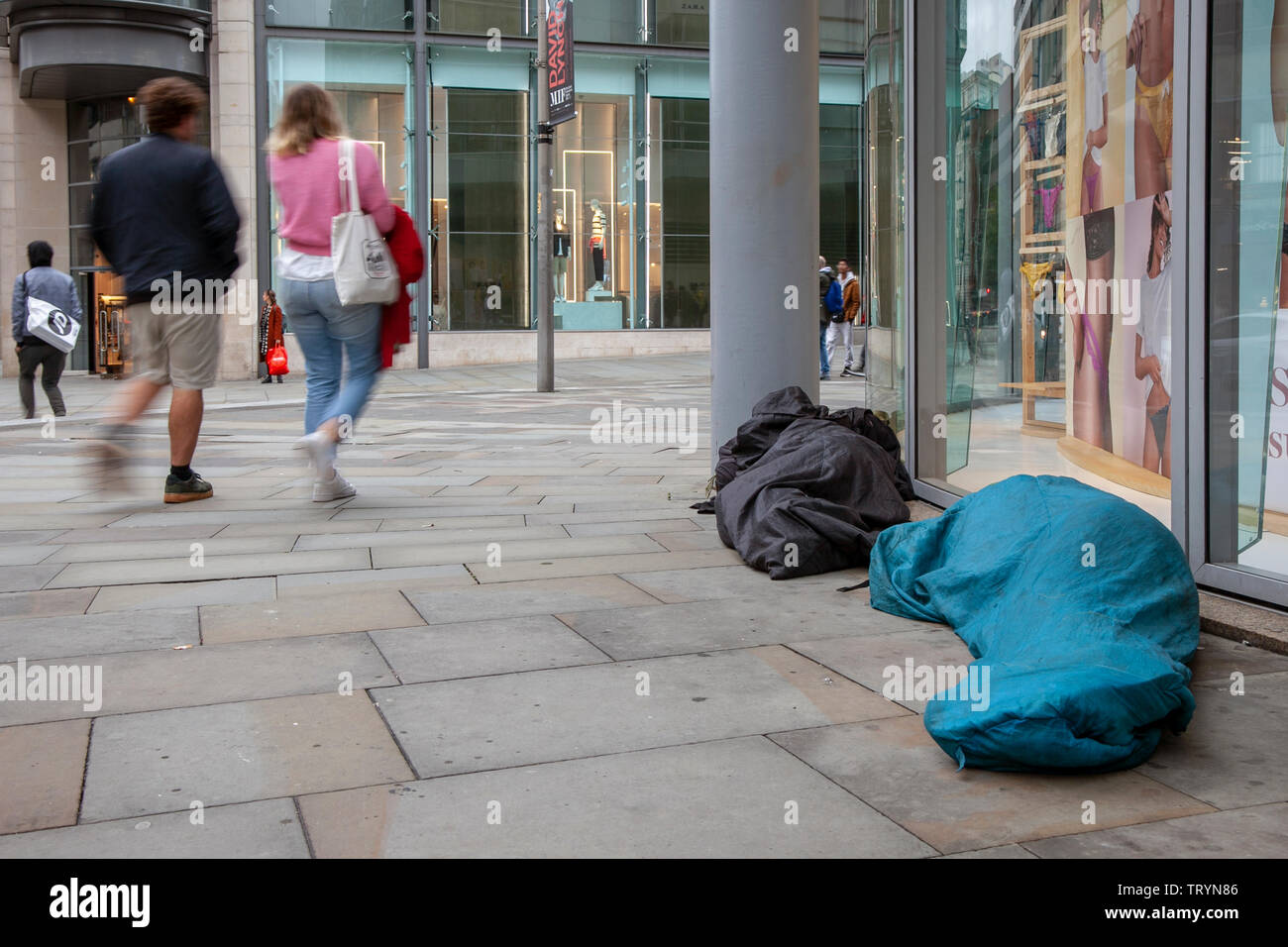 Homeless, homlessness, sleeping rough in Manchester cuty centre, UK - Stock Image