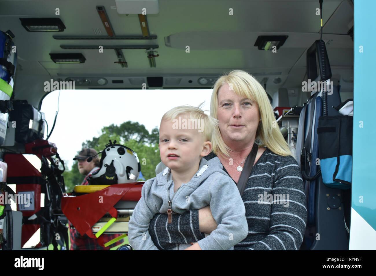 Leonardo AW169: G-KSST of Kent, Surrey & Sussex, Air Ambulance showing off the Ambulance from Radnor Park, Folkestone U.K - Stock Image