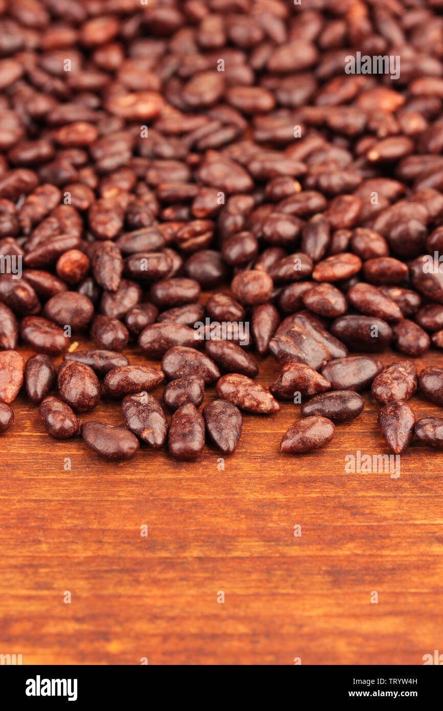 Sunflower grains in chocolate, on brown  wooden background Stock Photo