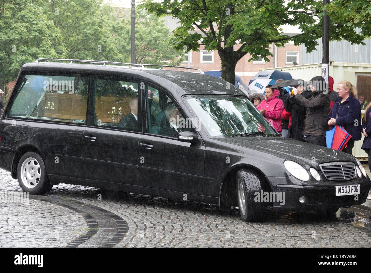 Prescot, Merseyside, UK. June 13th 2019.  Family, friends and celebrities pay their respects at the funeral service of Liverpool born comedian Freddie Starr at Prescot Parish Church.  Freddie who was 76yrs old died after a heart attack at his Spanish home in the Costa Del Sol on May 9th.  Freddie rose to fame in the 1970s, after appearing on Opportunity Knocks TV show.  Later, in the 1990s, Freddie starred in several television shows including An Audience with Freddie Starr before presenting game show, Beat the Crusher. Credit: Ken Biggs/Alamy Live News. - Stock Image