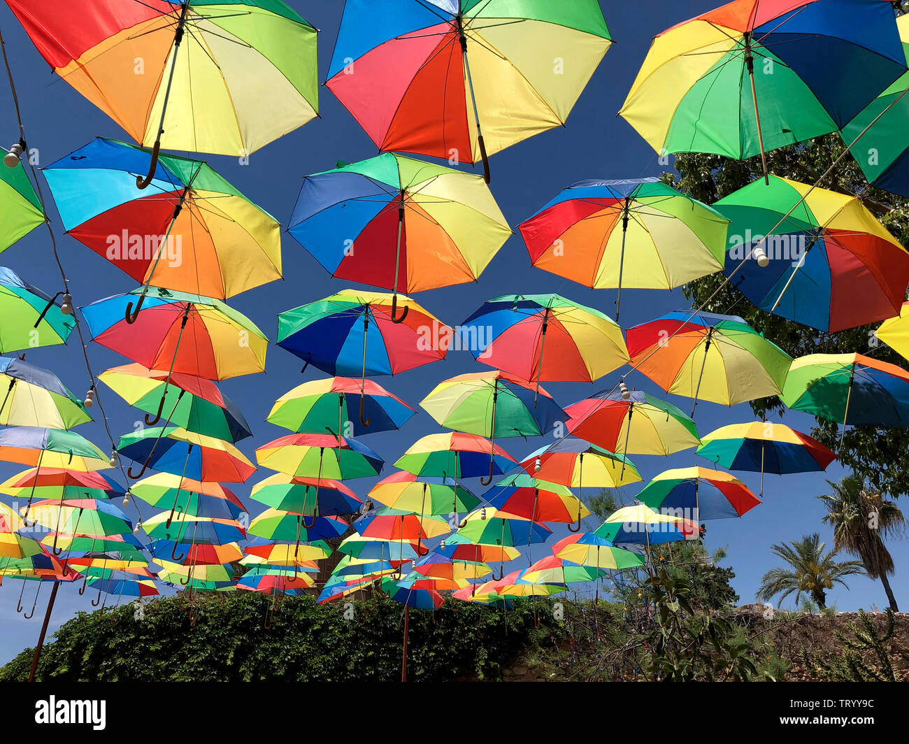 Display of umbrellas above a square in the city of Famagusta in the Turkish Republic of Northern Cyprus. Stock Photo