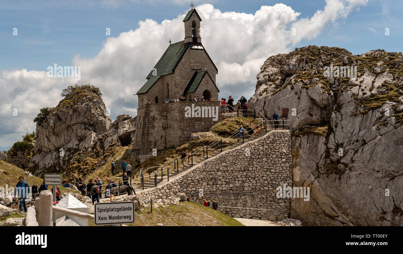Bayrischzell, Bavaria, Germany - June 1, 2019.  The tiny Wendelsteinkircherl highest church attracts many tourists - Stock Image