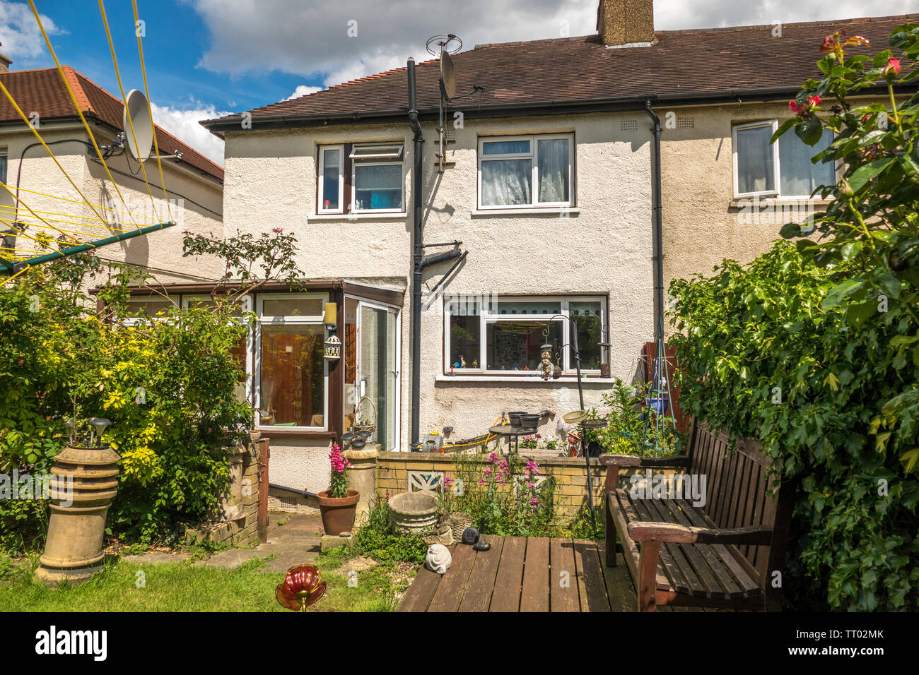 The rear of a modest end of terrace, 1920s, ex-local authority council house and garden, in the sunshine. South Ealing, London W5, England, UK. - Stock Image