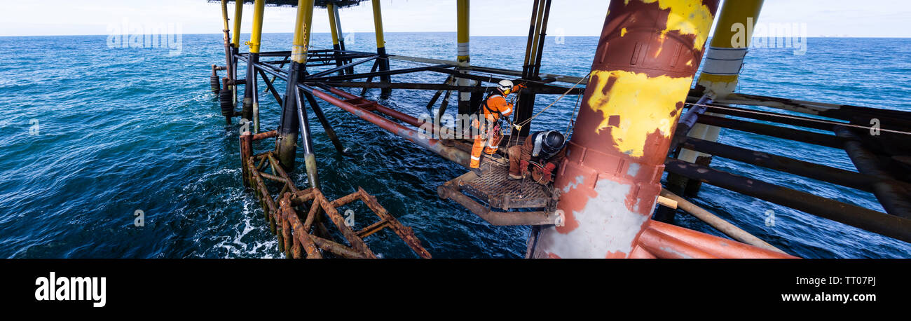 Rope access decomisining of oil and gas platform - Stock Image