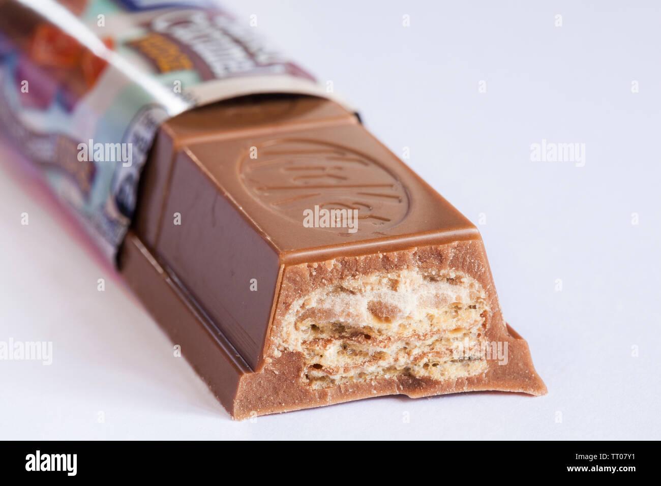 Nestle KitKat chunky salted caramel fudge bar opened to show contents set on white background - kit kat - Stock Image