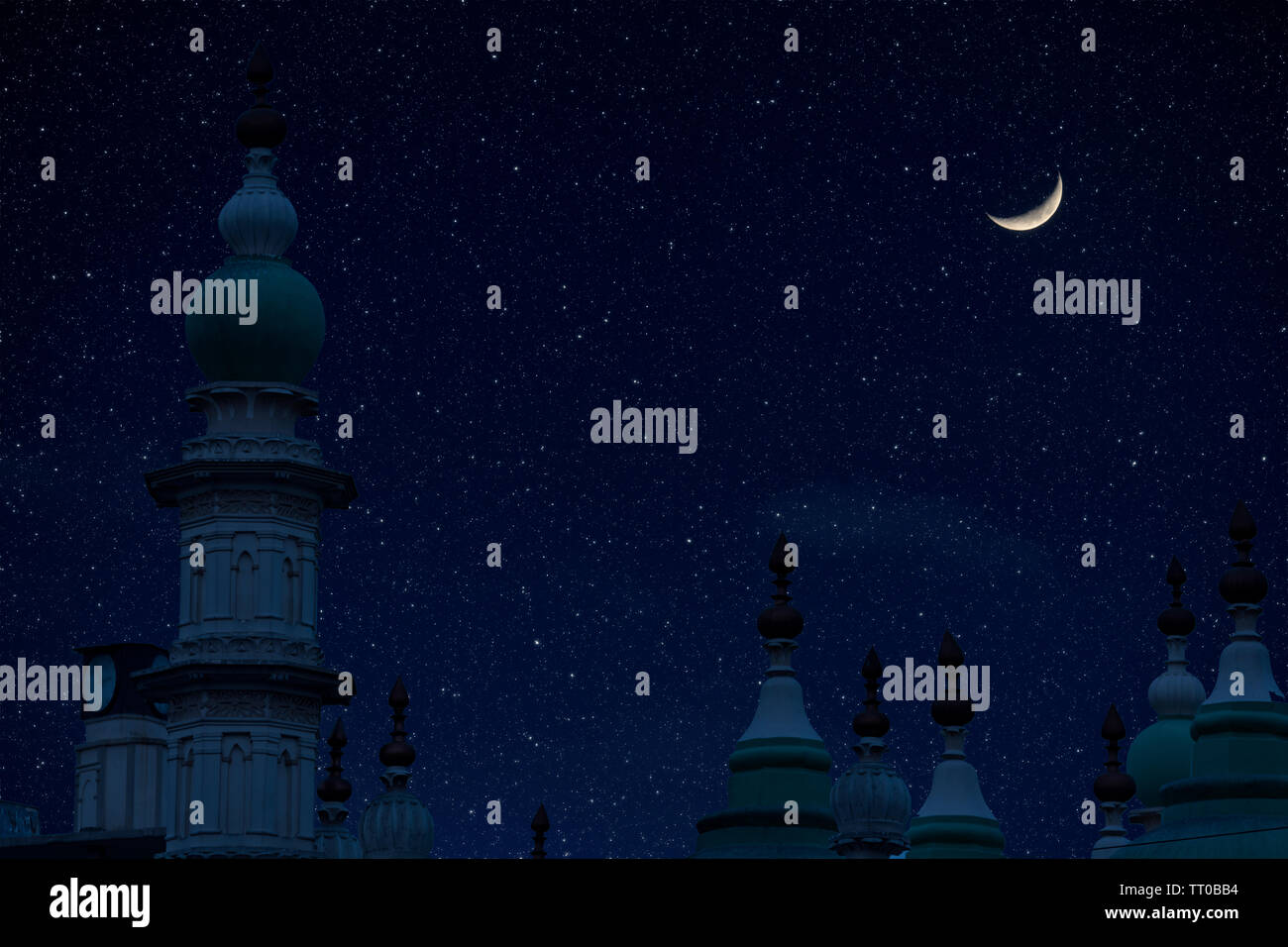 Top of mosque in Eid Ul fitr night with moon and star in night sky - Stock Image