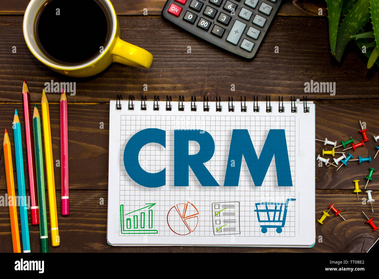 CRM. Customer Relationship Management. Tablet on the office Desk - Stock Image