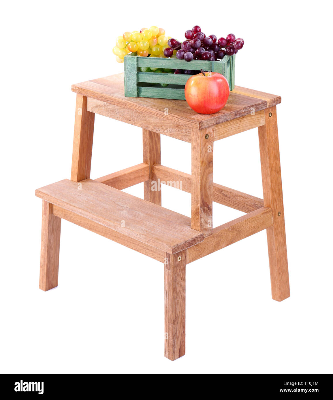 Wooden box with fruits, on small wooden ladder, isolated on