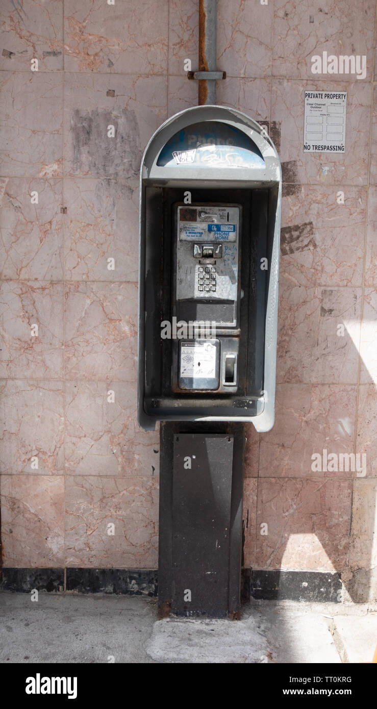 Old out of service broken pay phone - Stock Image