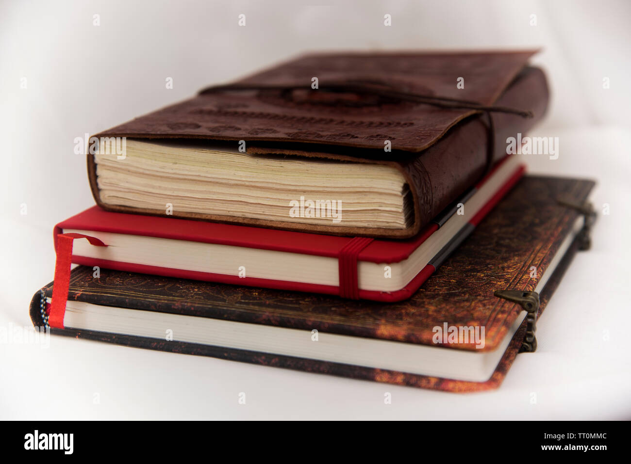 vintage notebooks in a still life - Stock Image