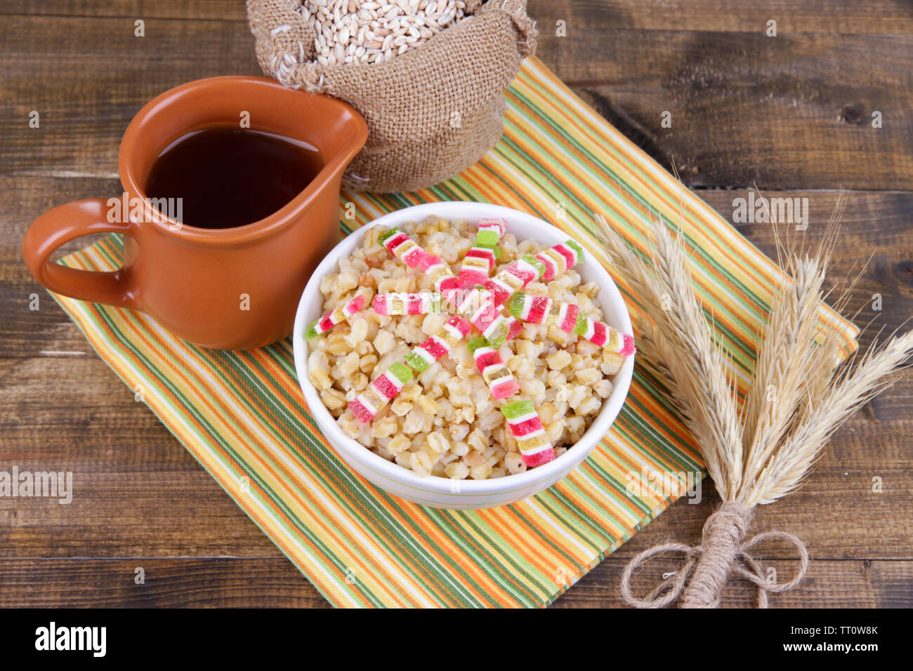Bowl with kutia -  traditional Christmas sweet meal in Ukraine, Belarus and Poland, on wooden background - Stock Image