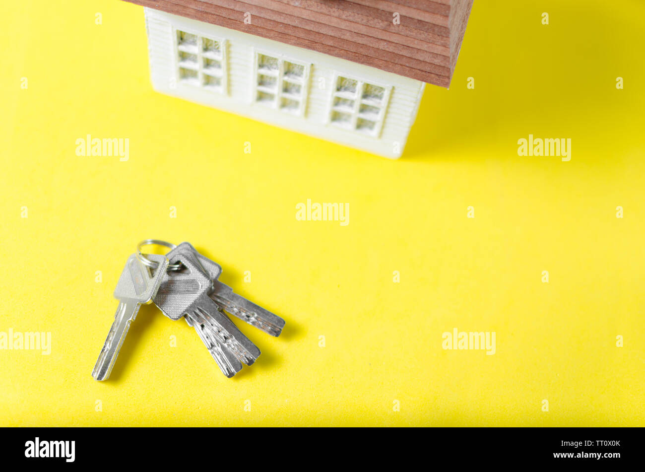 House keys on yellow background.Family dream house, apartment, housing.Mortgage loan - Stock Image