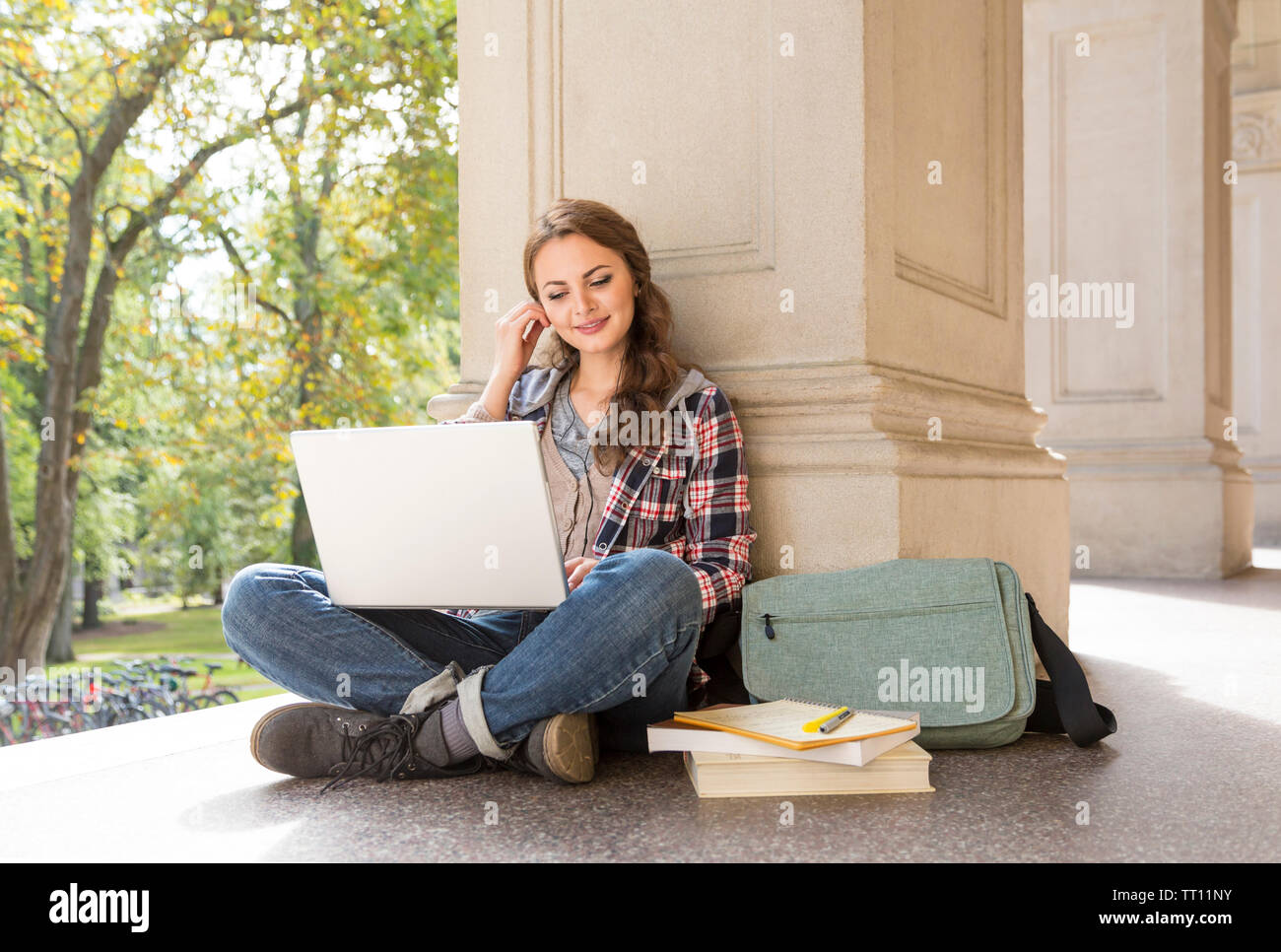 Young Woman Female College University Student With Earbuds Headphones Studying Using Laptop Computer Stock Photo Alamy