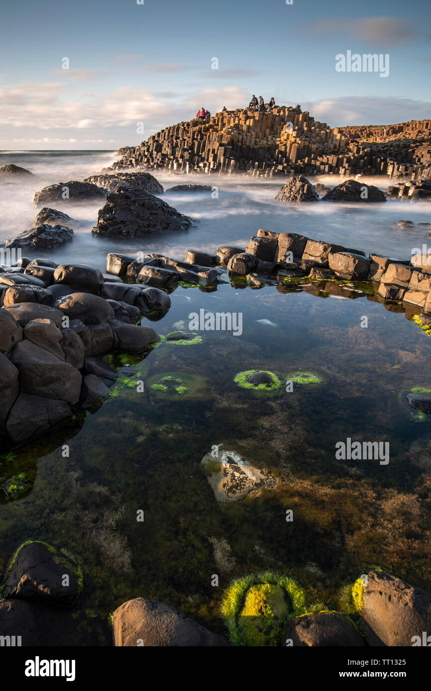 Tourists on the Giant's Causeway in County Antrim, Northern Ireland Stock Photo