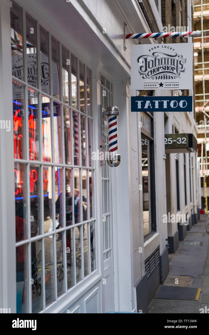 Johnny's Chop Shop, a mens barber shop and tattoo parlour in Marshall Street, Soho, London Stock Photo