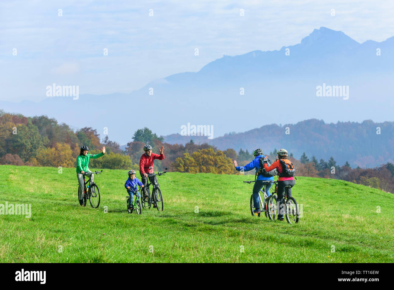 Cyclists meet in autumn landscape - Stock Image