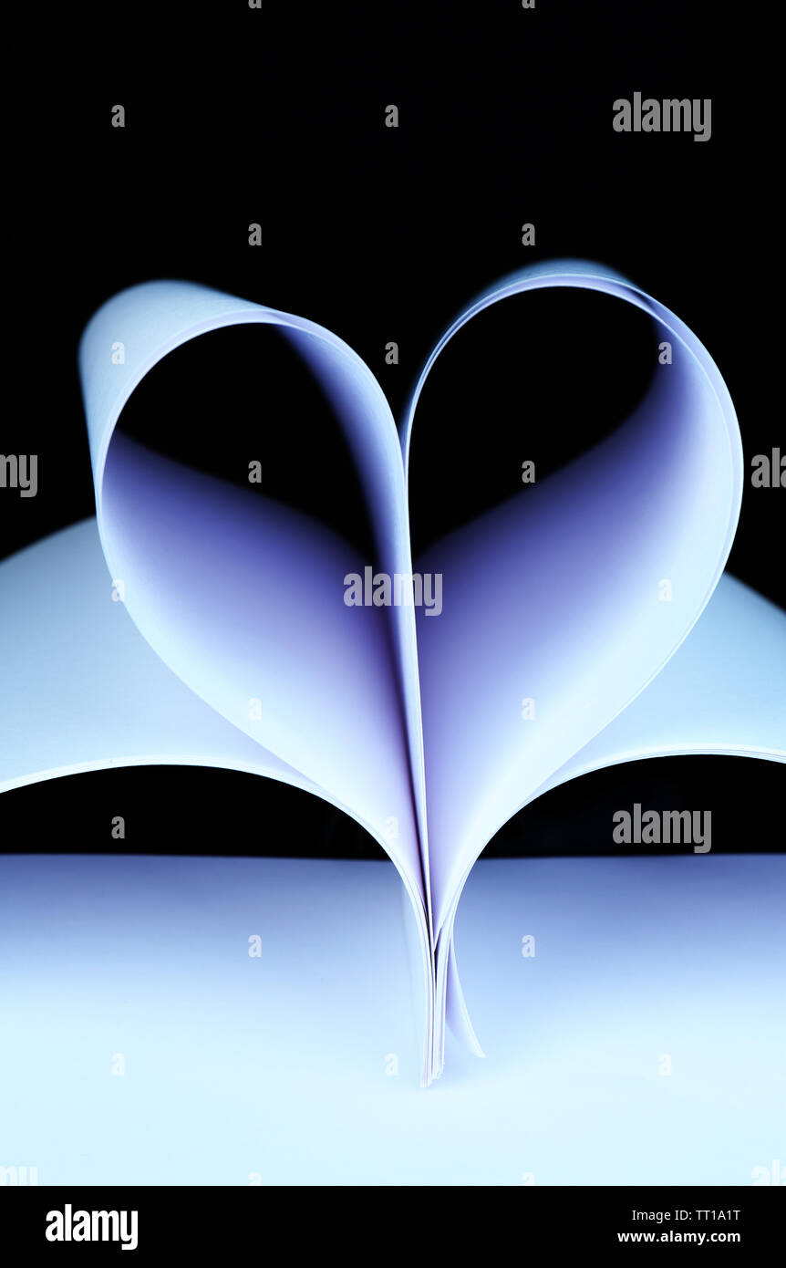 White paper in shape of heart on black background close-up Stock Photo