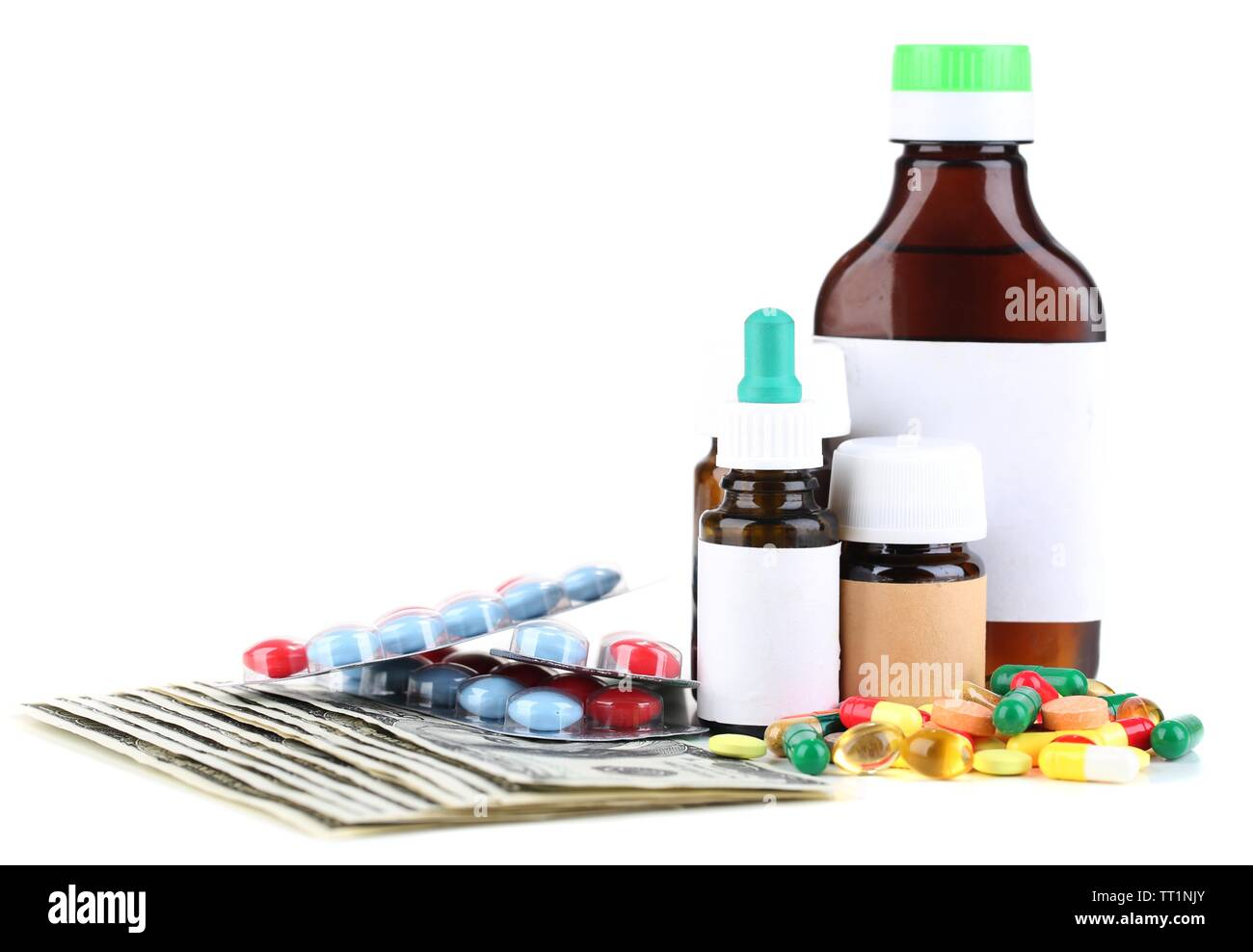 Prescription drugs on money background representing rising health care costs. Isolated on white - Stock Image