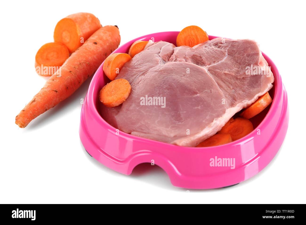 Natural food for pets in plastic bowl isolated on white - Stock Image