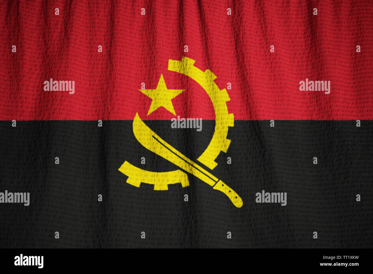 Ruffled Flag of Angola Blowing in Wind - Stock Image